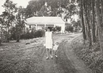 Erna, pregnant, walking to hospital 1970
